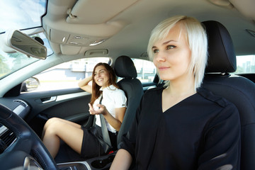 two girls in the car
