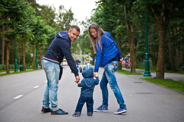 happy family with baby walking