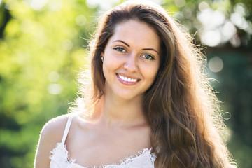 Smiling girl in summer park