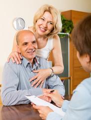 Mature couple filling questionnaire
