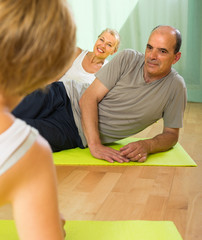 Senior people on fitness with instructor