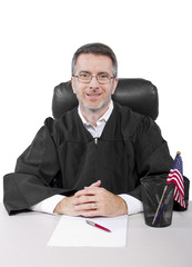 middle aged caucasian american judge in a robe sitting