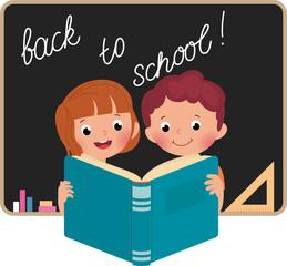 Children at school reading a book
