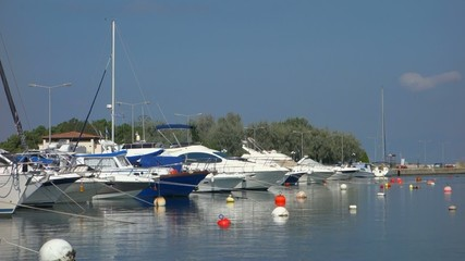 Boats and yachts in the Port of Fanari, Greece