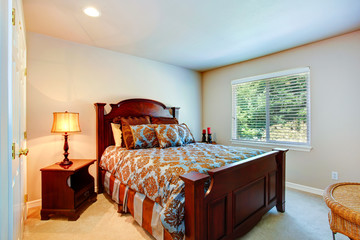 Light bedroom with wood carved furniture