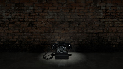 Old black telephone on brick wall