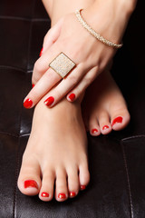 Portrait of manicured nails and pedicured toes with nail polish