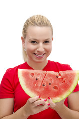 Blonde girl in red shirt holding watermelon