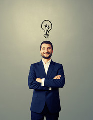 smiley businessman with drawing light bulb