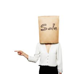 woman hiding under shopping bag