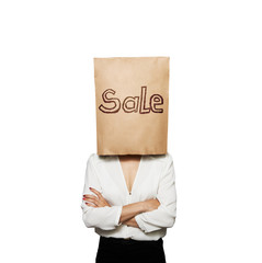 woman under paper bag with sale written