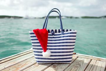 close up of beach bag and santa helper hat