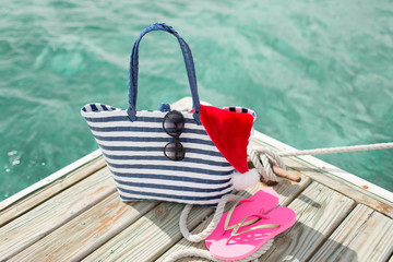 close up of beach accessories and santa helper hat