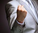 The businessman, a gesture, a finger.