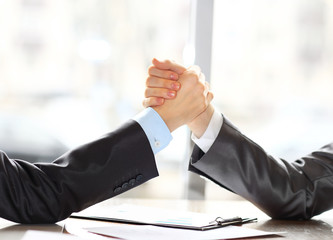 businessmen press hands each other on a forward