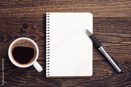 Fotobehang Koffie Cup of coffee and notepad