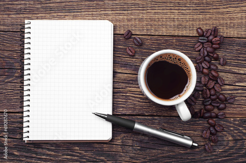 Foto op Canvas Koffie Notepad and cup of coffee