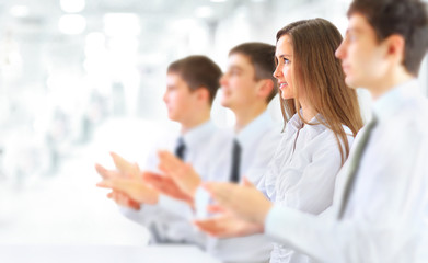 Happy business group applauding at the office