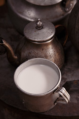 milk mug and old teapot and kettle in a kyrgyz yurt kitchen
