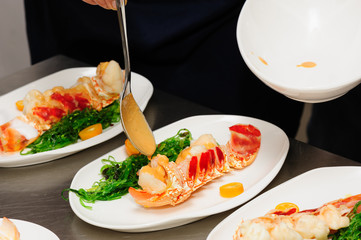 Decorating cooked lobster on plate