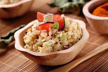 riso speziato con prugne e kiwi