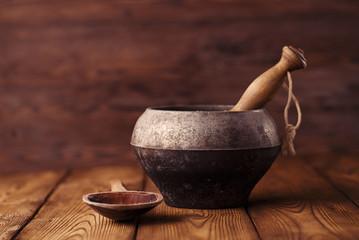 vintage sooty iron stove pot on wood