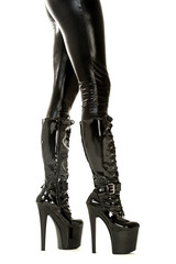 Sexy legs in latex stockings and high heels fetish boots