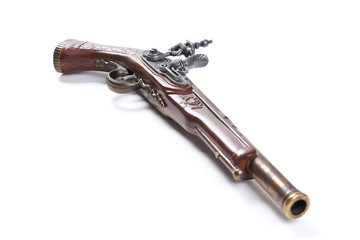 Old wooden gun, upper side, selective focus, on white background