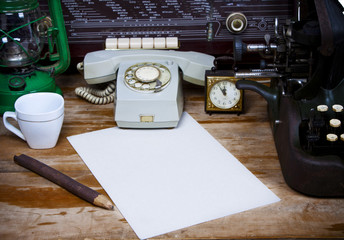 Still life with retro typewriter, alarm clock, telephone and old