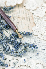 vintage ink pen, dried lavender flowers and old love letters