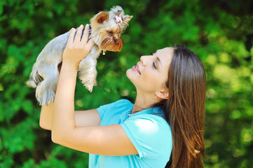 Beautiful girl portrait with puppy yorkshire terrier