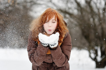 Young beautiful woman having fun in winter