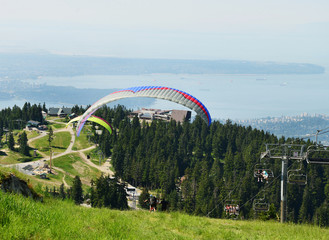 Paragliders Take off from Grouse Mountain Vancouver