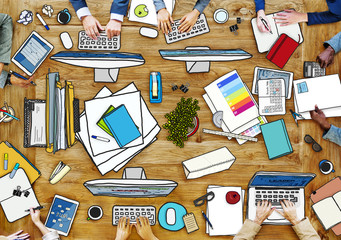 People Working at Messy Table Photo and Illustration