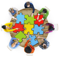 Multiethnic Group of People with Jigsaw Puzzle