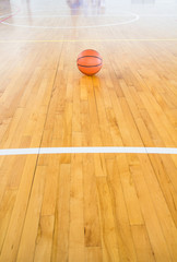 Basketball ball over floor in the gym