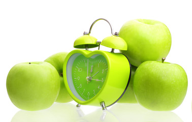 Green alarm clock heart shape and apples