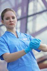 female doctor in medical gloves