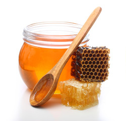 Glass bowl with honey and slice comb