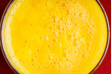 Diet healthy nutrition. Closeup of fresh yellow fruit juice
