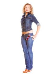 Denim fashion. Full length blonde girl in blue jeans