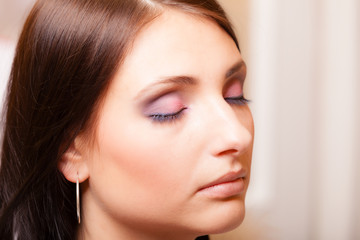 Portrait beautiful latin woman with closing eyes pink eyeshadows