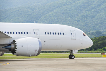 Commercial airplane taxiing to runway