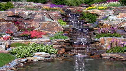 Garden waterfall on the rock