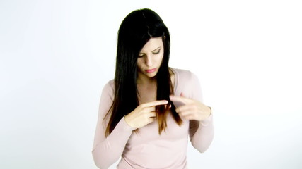 Beautiful woman unhappy about split ends hair