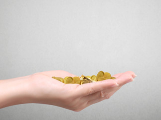 Holding gold coins