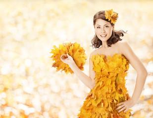 Autumn woman leaves dress, fall season fashion clothes