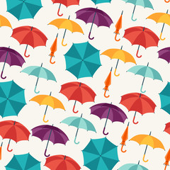 Seamless pattern with cute multicolor flat umbrellas.