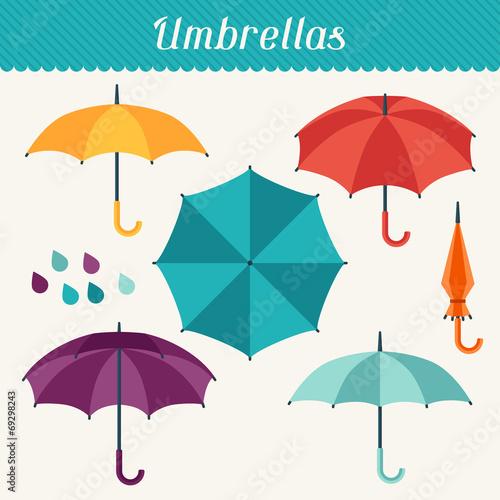 Set of cute multicolor umbrellas in flat design style. - 69298243