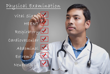 Young physician ticking physical examination checklist